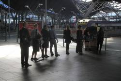 Queue of V/Line passengers topping up their myki at Southern Cross Station