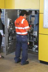 Vix technician fixing a defective myki machine at Sunshine station