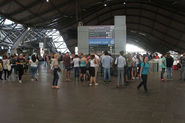 Long line to use the Myki machines at Southern Cross Station