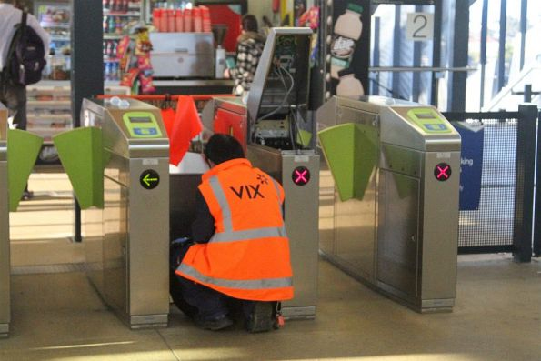 Vix technician repairing a set of myki gates at Sunshine station
