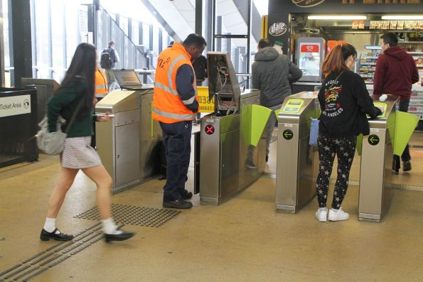 Vix technician repairing a failed myki gate at Sunshine station