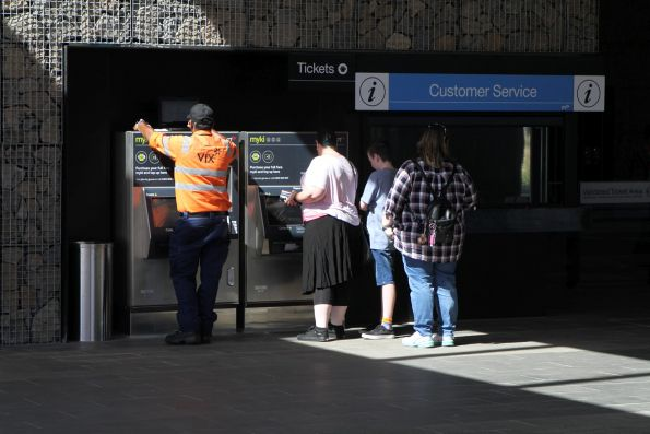 Vix technician work on the Myki machine at Mernda station