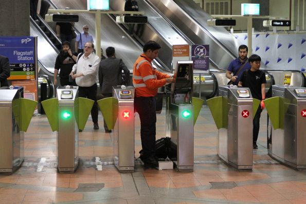 Vix technician repairing a myki gate at Flagstaff station