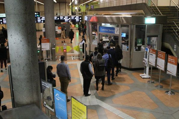 Long line of passengers waiting to top up their myki at Flagstaff station
