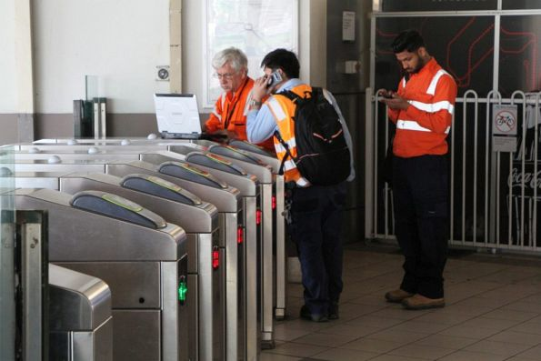 Vix technicians work on the Myki gates at Flinders Street Station