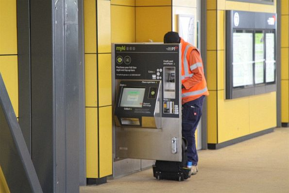 Vix technician at work on a failed myki machine at Sunshine