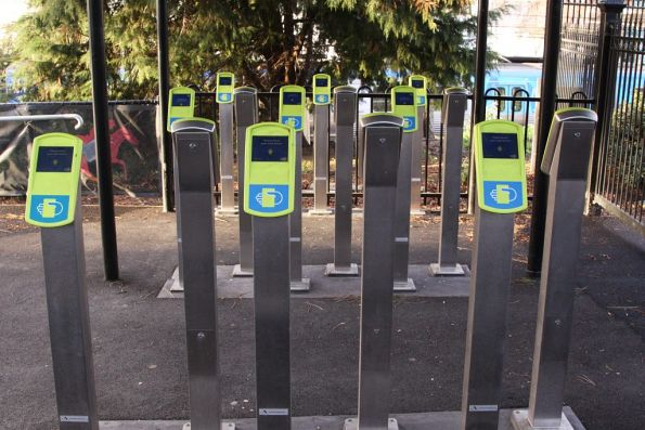 A bank of 18 myki FPDs at one exit of Flemington Racecourse platform 2