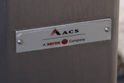 Badge on the 2nd tranche of Myki readers: 'ACS / A Xerox Company'