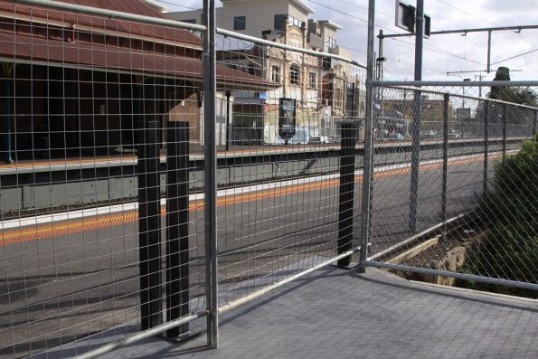 Temporary fencing blocks the new station exit at Yarraville