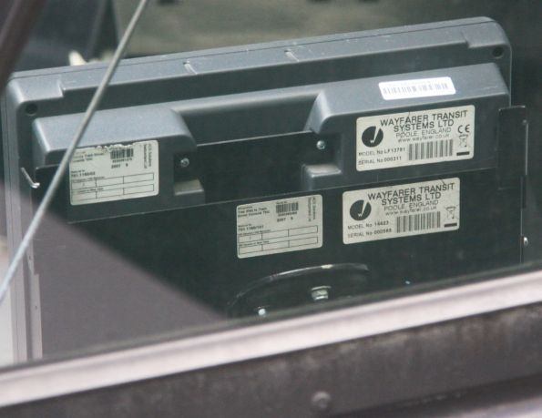 Wayfarer and ACS Solutions serial number stickers on the rear of a Tram Driver Console