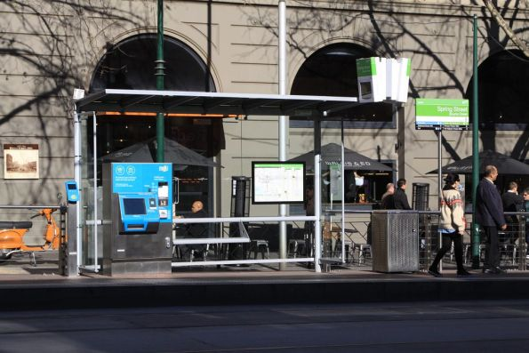 Myki machines on a tram stop on Bourke Street at Spring Street