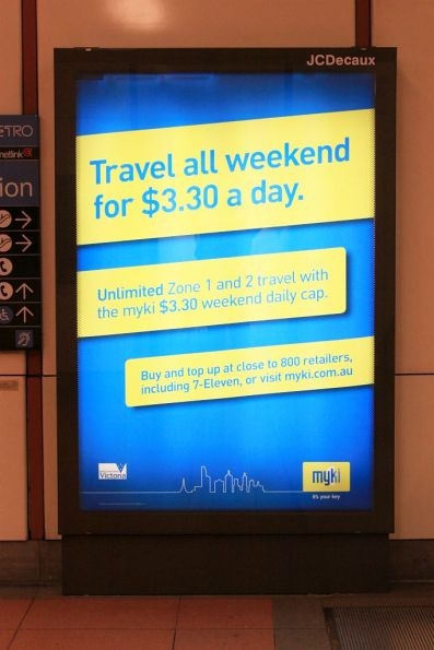 Myki 'Travel all weekend for $3.30 a day' advert at a railway station