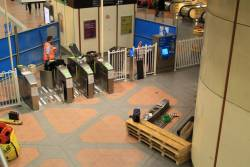 Installing new Myki gates at the north entrance to Flagstaff station