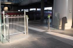Bodge job fencing around the Myki FPDs at the entrance to platform 1 at Southern Cross