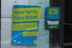 'New  term. New ticket' poster in a 7-Eleven window