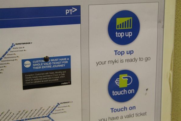 Old Metcard-era 'customer must have a single valid ticket for entire journey' note affixed to a Myki poster