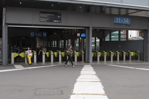 Bank of eight plus seven Myki gates at the western Bourke Street entrance at Southern Cross