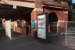 Advertising panel at Newmarket station blocking a wider platform exit
