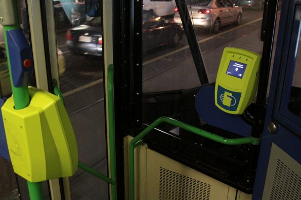 Given only one passenger can use the front door of a B2 class tram at a time, why have two Myki readers?