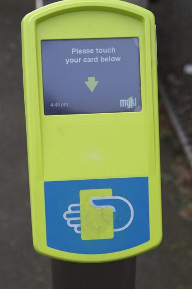 Must be new - a Myki reader without the touch pad printing scuffed off