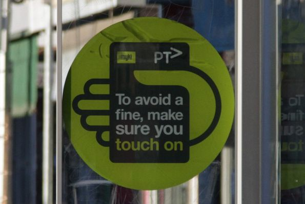 New PTV fare evasion campaign signs at a tram stop - 'To avoid a fine, make sure you touch on'