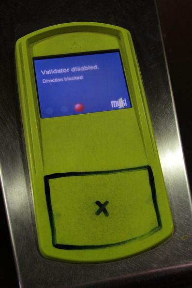 Myki reader with the blue Myki logo rubbed off, replaced by a target drawn on with texta