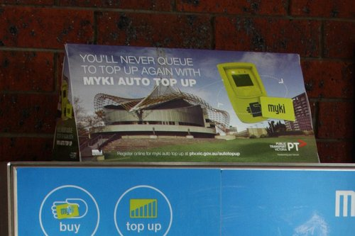 'You'll never wait in line with Myki auto top up' advertisement, sitting atop a CVM