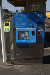 Vandalised Myki ticket machine at North Shore station, with three holes smashed in the touch screen