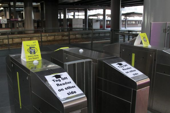 'Tag off reader other side' notice at the entrance to platform 1 at Southern Cross