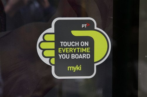 New 'Touch on every time you board' stickers on tram doors