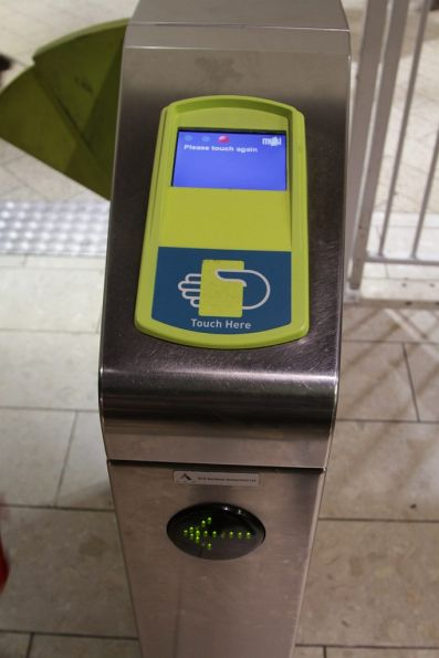 Myki reader with new 'Touch here' text screen printed on it