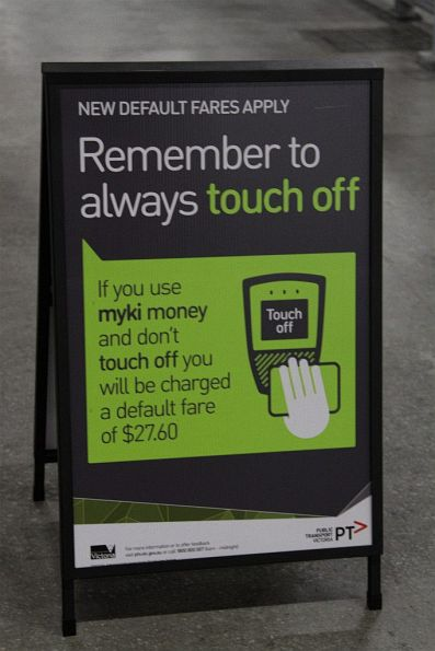 'Remember to always touch off or you will be charged a default fare of $27.60' sign at the coach terminal at Southern Cross