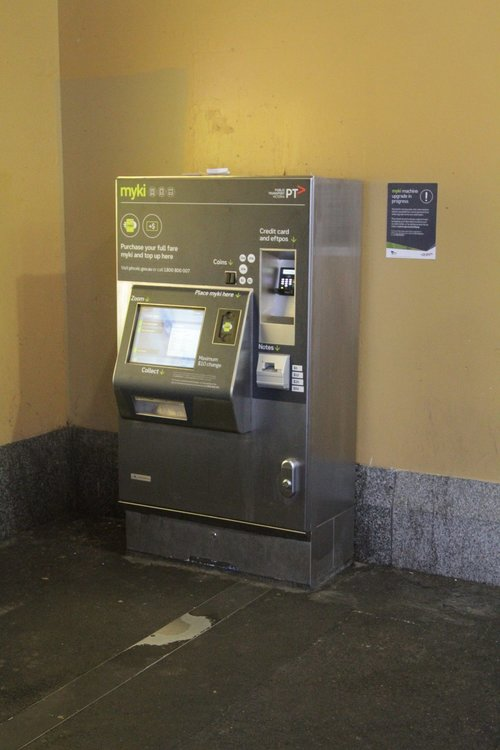 Myki machine at Flinders Street Station, with new branding stickers applied to the front