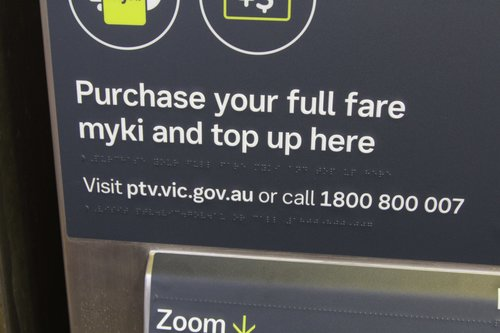 Braille text still features on a rebranded Myki machine at Flinders Street Station