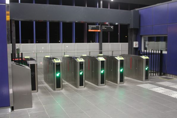 Myki gates lead from the overhead concourse to Ringwood platform 1 and 2