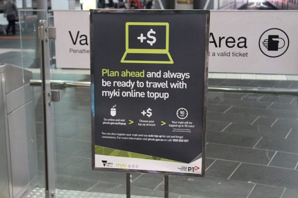 Poster at Southern Cross Station promoting Myki online topup