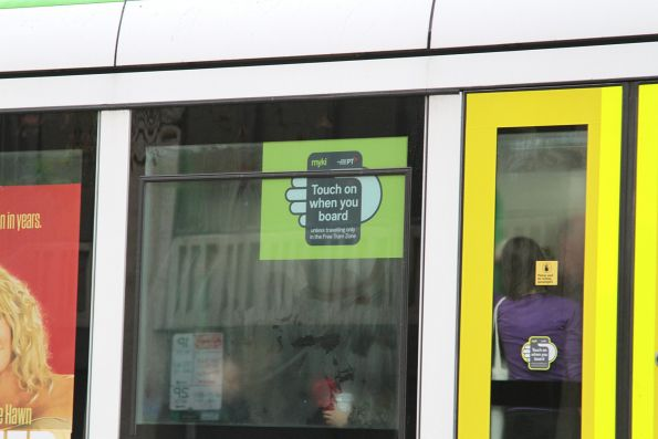 'Touch on when you board' sticker on the side window of a C class tram
