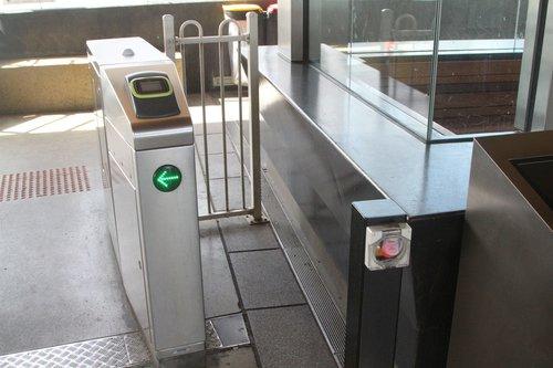 Emergency release button beside a set of myki gates
