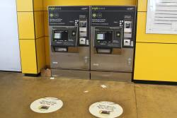 'Never queue again with myki auto top up' promotional stickers in front of a myki machine