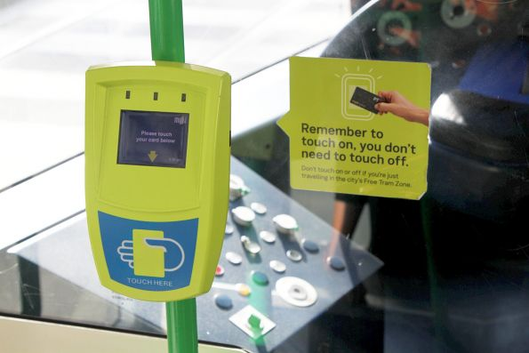 'Remember to touch on, you don't need to touch off' stickers onboard a C class tram