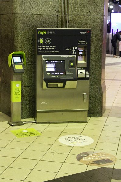 Full sized Myki machine beside a much smaller Quick Topup machine