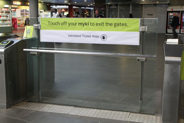 'Touch off your myki to exit the gates' signage at Southern Cross Station