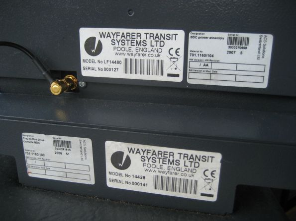 Serial number stickers on base and printer unit of driver's console