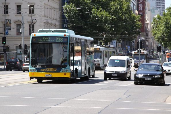 National Bus #545 rego 5841AO on a route 238 service along Flinders Street beside the Viaduct