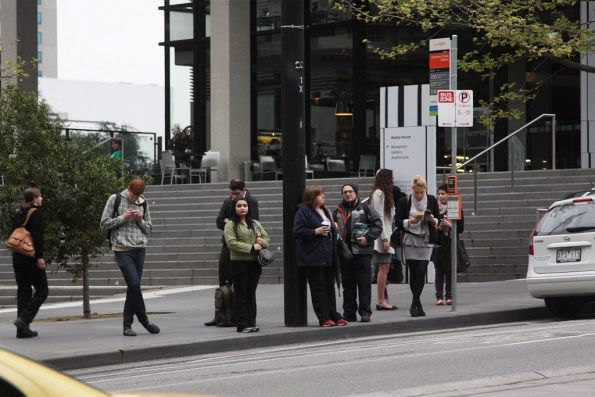 Decent sized crowd waiting outside Southern Cross Station for the route 235/237/238 buses to Fishermans Bend