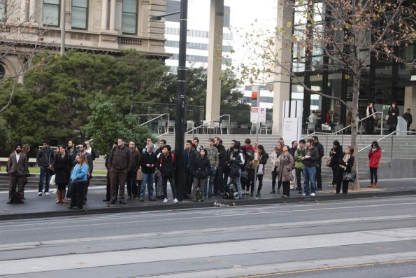 Five minutes later, the crowd for the Fishermans Bend bus has grown