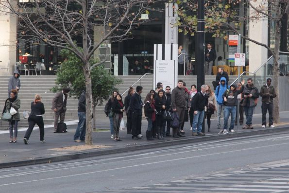 Crowd of passengers for the Fishermans Bend bus already growing
