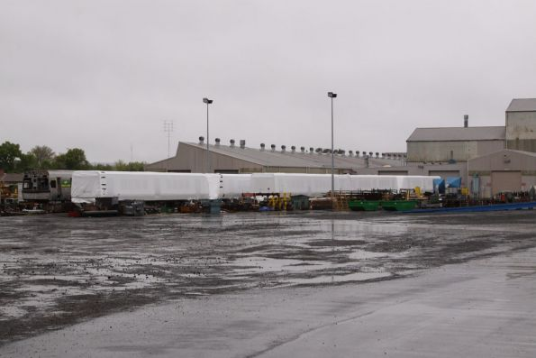 X'Trapolis body shells still in factory wrapping at UGL Ballarat: six cars all up, all with bogies fitted
