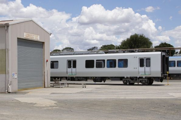 Unliveried X'Trapolis T car sitting outside the Ballarat Workshops sheds