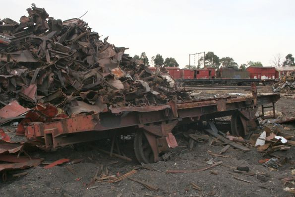 Four wheeled open wagon underframe and a pile of scrap